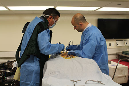 Dr. Ali Baaj (right) in the lab at the Complex Spine CME