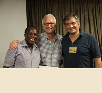 Dr. Joseph Kahamba (left), Dr. Stieg, and Dr. Härtl celebrate at the end of a successful course.