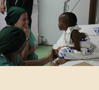 Cornell nurse Brenna McCann with a patient.
