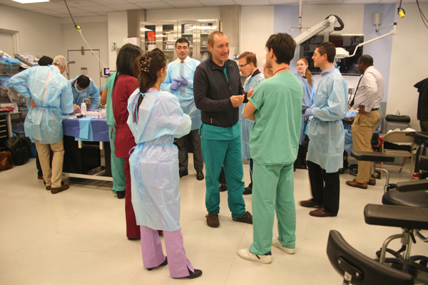 Dr. Antonio Bernardo, center, directs the Surgical Innovations Lab