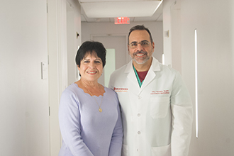 Rosanne Miller with Dr. Athos Patsalides