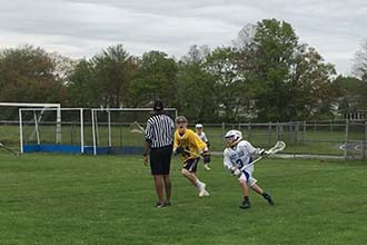 Cole playing lacrosse