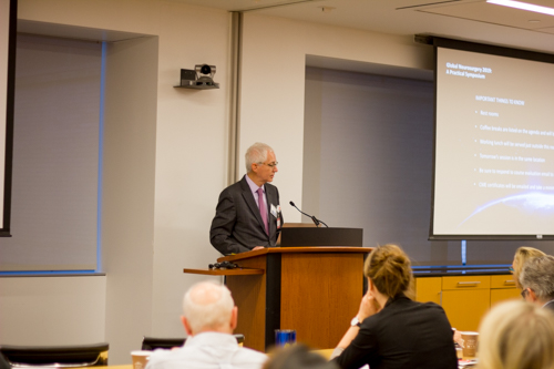 Dr. Eric Elowitz prepares to introduce his colleague, Dr. Walter Johnson