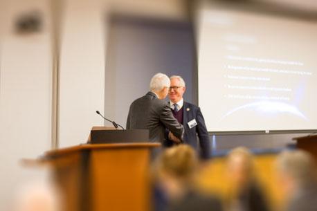 Dr. Eric Elowitz & Dr. Walter Johnson shake hands
