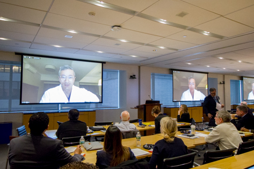 Dr. Walter Jean addresses attendees from Vietnam via webcam