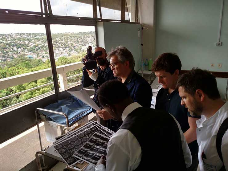 Dr. Hartl reviewing scans with the team in Tanzania