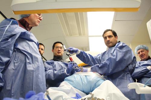 Dr. Michael Virk demonstrating new MIS techniques