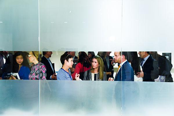 Guests assemble for the Elliott Erwitt exhibit at Edwynn Houk Gallery