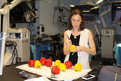 Dr. Hoffman prepares peppers for the students