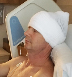 Peter Benson resting comfortably after his surgery to remove an acoustic neuroma