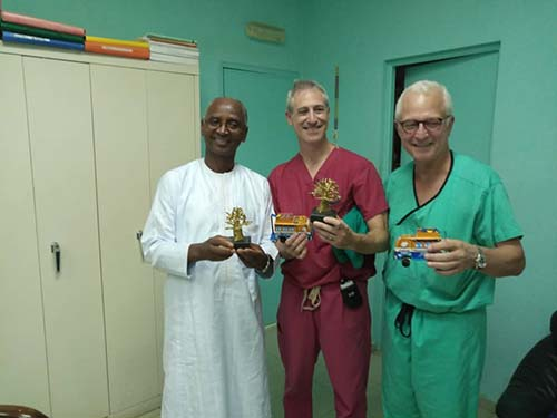 Dr. Seydou Badiane, chairman of Fann Hospital's neurosurgery program, with Dr. Greenfield and Dr. Stieg