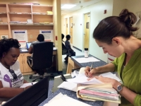 Dr. Hoffman updates a patient chart during her mission trip to Antigua