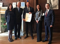 Dr. Antonio Bernardo, center, being presented with the Order of Merit by the Honorable Francesco Genuardi, Consul General of Italy in New York, and by Deputy Consuls General Roberto Frangione, Isabella Periotto, and Chiara Saulle.