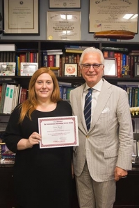 Erin with the chairman, Dr. Philip Stieg