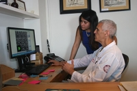 Dr. Mark Souweidane reviews MRI scans of DIPG tumors with Fatima Nathalia Morales