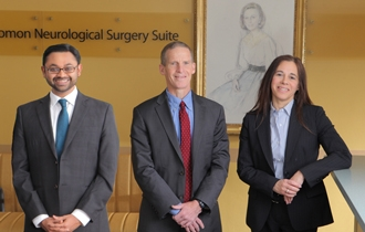 Dr. Rajiv Magge (left) joins neuro-oncology director Dr. Howard Fine and stereotactic radiosurgery director Dr. Susan Pannullo in providing the best multidisciplinary care for neuro-oncology patients.