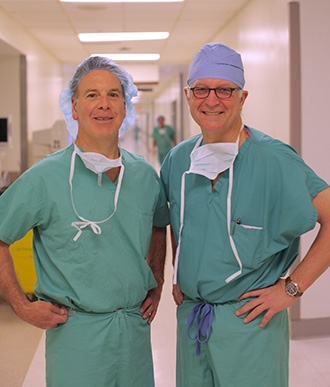 Dr. Henry Spinelli and Dr. Philip E. Stieg