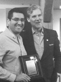 Dr. Rodrigo Navarro-Ramirez (left) receives the award for Best Basic Research Oral Presentation from Dr. Michael Fehlings, president of AO Spine North America
